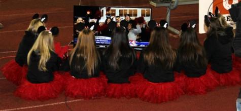 JAHS Cheerleaders watch the news