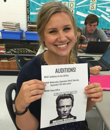 Fall play director, Tinberg shows off the audition sign for Jonathan Alder High School's school play.