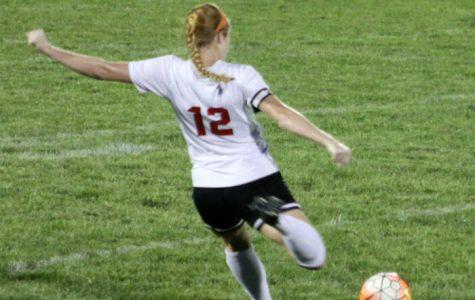 Senior, Riley Gruenbaum winds up to kick a penalty kick.