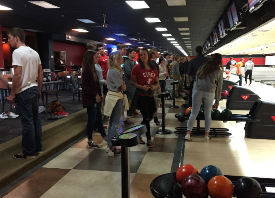 Seniors pateintly wait for their turn to bowl.
