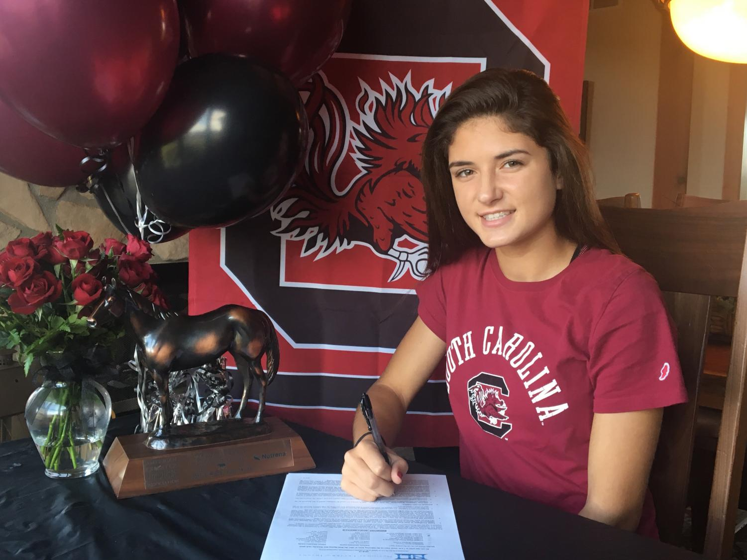 Thorpe signing the National Letter of Intent to join the University of South Carolina's equestrian team.