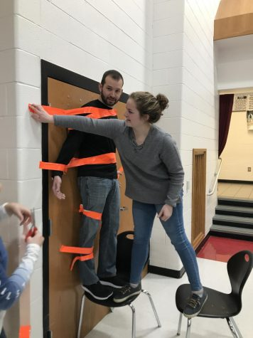 Glass taped to wall–for a good cause