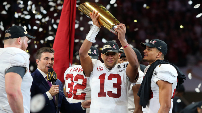 Tua+Tagovailoa%2C+Alabama+Quarterback%2C+hoists+the+2017+CFB+Playoff+National+Championship+trophy.