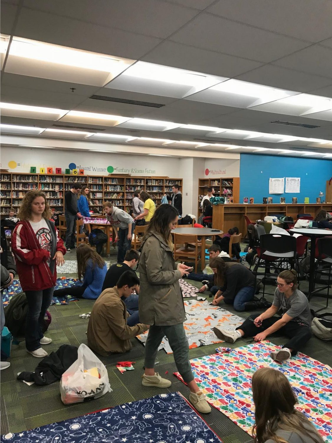 Jonathan Alder National Honors Society gathers to make no-sew blankets for children at Nationwide Children's Hospital.