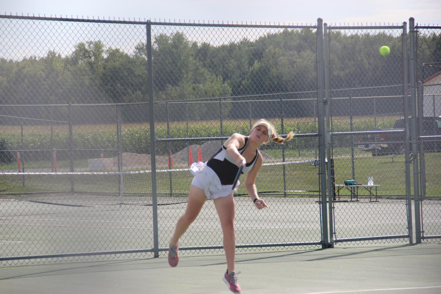 Grove concentrates on her swing as she sends the ball over the net.