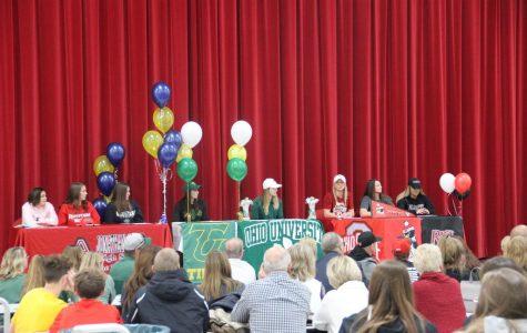 The seven senior prepare to sign to their chosen schools