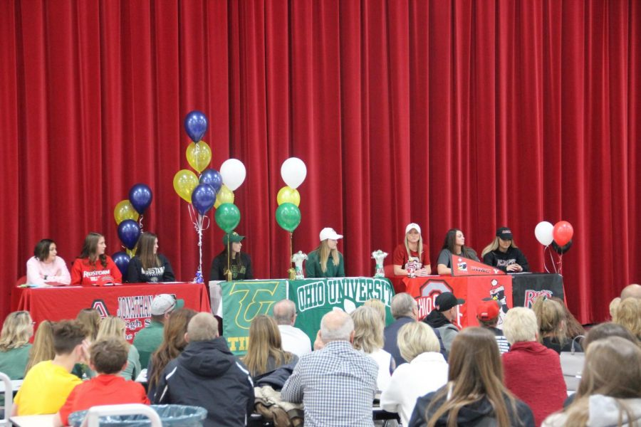 The seven senior prepare to sign to their chosen schools