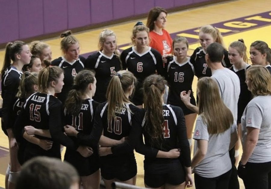 JAHS+volleyball+team+huddles+together+before+facing+Parma+Heights+Holy+Name+in+the+Regional+Final+match.+