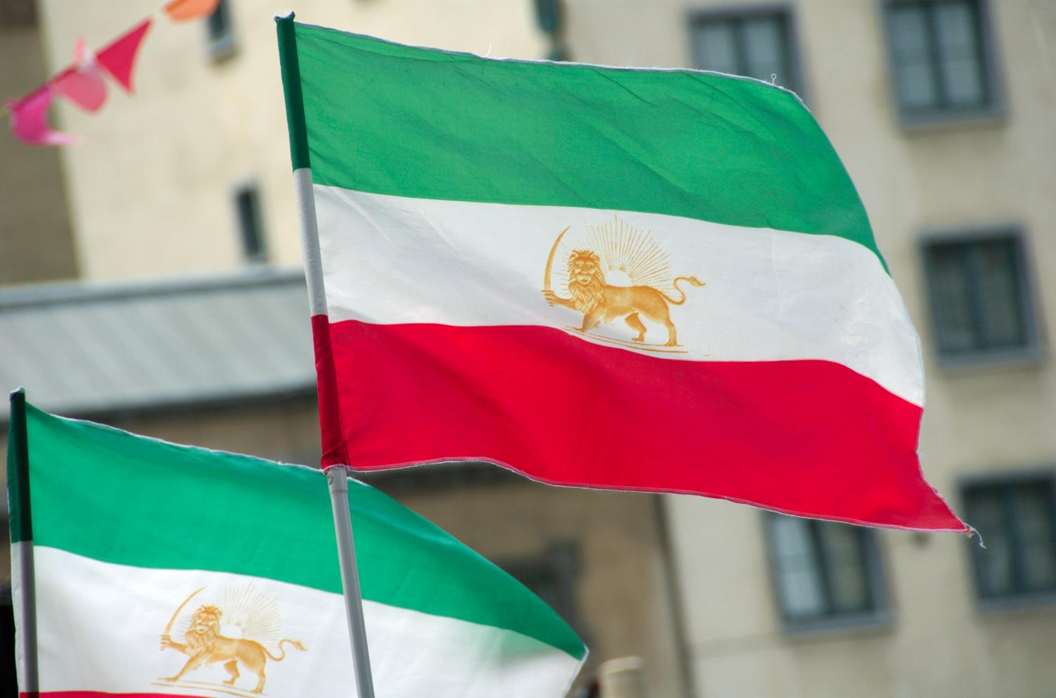 The flag of Iran proudly waves against the gusts of wind, courtesy of
