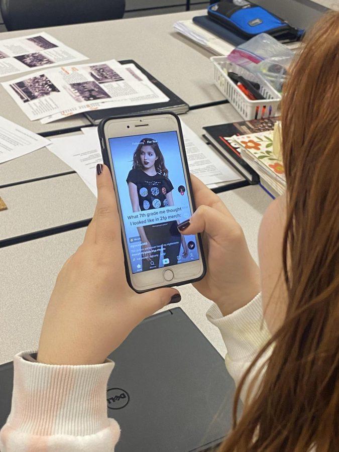 Junior Madeline Frambes scrolls through the famous TikTok before Journalism class.