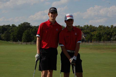 Seniors Brandon Gargac and Nick Sowers posing before their match.