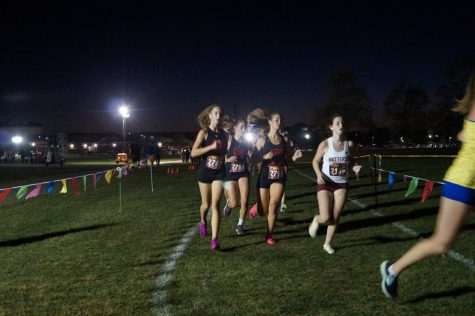 Sophomore Helena OConnor, Freshman Sarah Malone, and Sophomore Mattie Shoemaker during the Girls Open race (Photo taken by Megan Marling)
